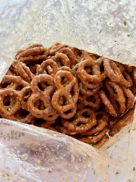 pretzels fully covered in the butter ranch seasoning in a zip top bag