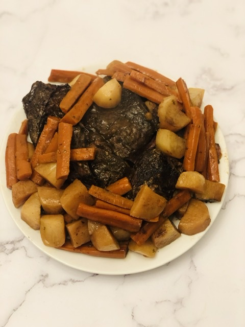 plate of beef roast with tender potatoes and carrots