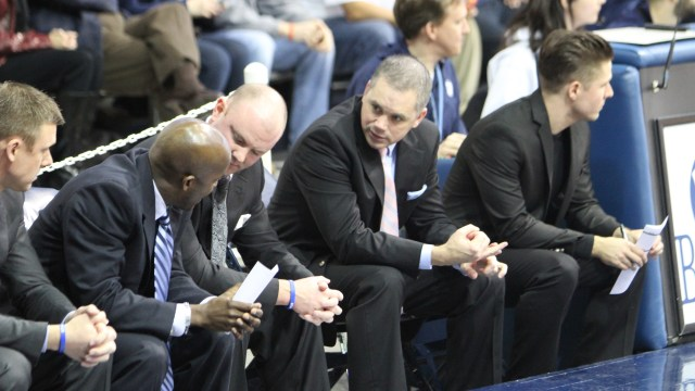 Chris Holtmann sitting on the bench during a game last season. Collegian file photo