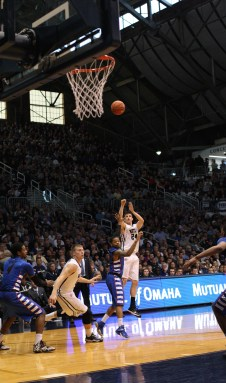 Junior Kellen Dunham shoots a three-pointer during an 83-73 win over DePaul Saturday at Hinkle Fieldhouse.