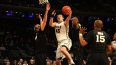 (Photo by Mike Andrews) Sophomore Andrew Chrabascz goes up for a shot during a 67-61 overtime loss against Xavier in the Big East Tournament Quarterfinals at Madison Square Garden.