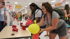 Li'Yonna McCallum (left) and Olivia Anton (right), freshman with the same first year seminar participate in a friendly competition at the late night Target event. Photo by Amy Street