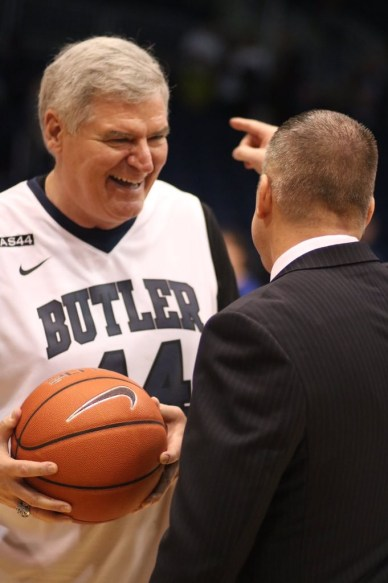 Coach Chris Holtmann hands Curt Smith, Andrew's father, the game ball. -Photo by Jimmy Lafakis