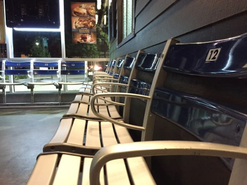 Stadium benches line the lobby of the restaurant.
