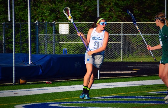 Current Butler sophomore lacrosse player Kelly Burger looks to make a move during a high school game. - Photo courtesy of Kelly Burger