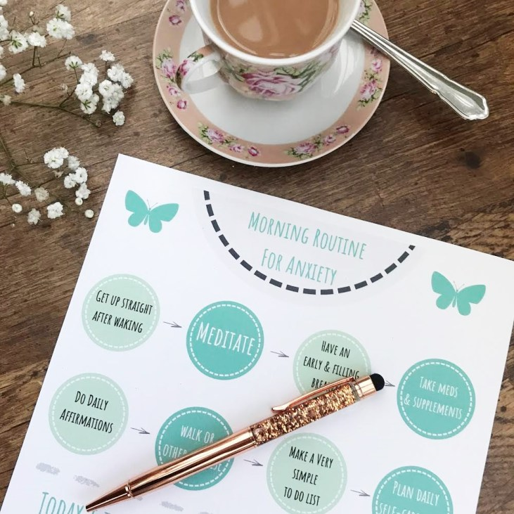 Photo of Morning Routine for Anxiety free printable with pen, white flowers and cup of tea