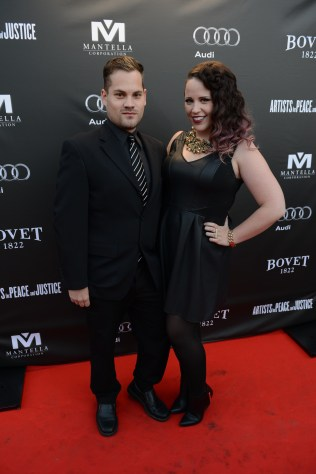 Stacey Kay and guest arrive at the Artists for Peace and Justice Festival Gala co-presented by Audi Canada at Casa Loma during the Toronto International Film Festival.