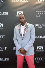 Kardinal Offishall arrives at the Artists for Peace and Justice Festival Gala co-presented by Audi Canada at Casa Loma during the Toronto International Film Festival.