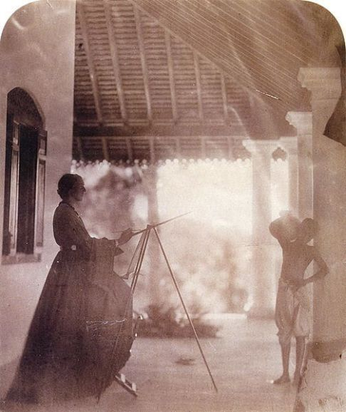 Marianne North painting a Tamil boy in Ceylon, 1877. (Photograph by Julia Margaret Cameron)