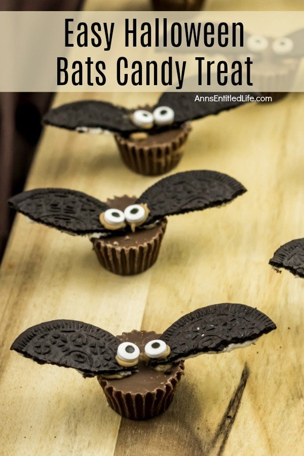 Reese's peanut butter cup with oreo cookie broken in half and iced in place as wings.  Eyeballs help make these treats look like bats.