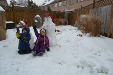 Abby and AIden with their first snowmen of the season