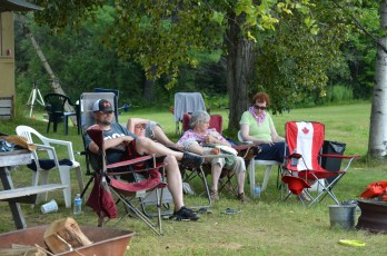 People watching the water fight. Luc napping and Joyce and Jackie visiting.