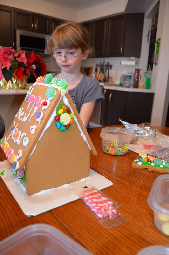 Kids making Gingerbread house
