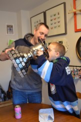 Aiden drinking cream soda from his trophy.