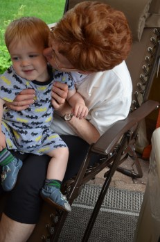 Cathy kissing her grandson Jasper