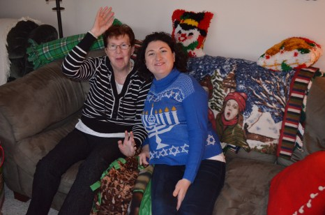 Melissa (& her ugly Christmas Sweater) hanging out with her Mom on the couch.