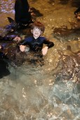 Aiden in the water petting the Stingrays