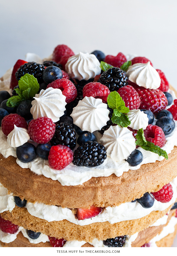 Eton Mess Cake - Inspired by the classic dessert, this cake combines crisp meringues, sweetened cream, fresh berries - layered between an airy sponge cake.   By Tessa Huff for TheCakeBlog.com