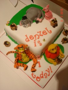 Winnie the Pooh and the gang cake with handmade toppers