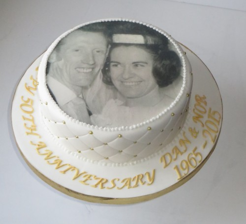 50th Wedding  Anniversary Cake with Couples photograph