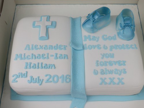 Christening Bible cake with booties topper