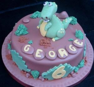 Green dinosaur cake topper