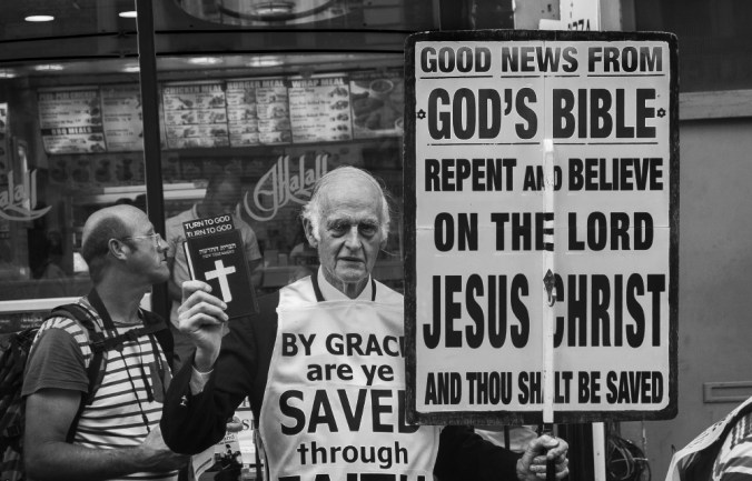 Man with Sign About Accepting Jesus