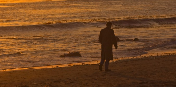 Man Walking Alone at Sunset