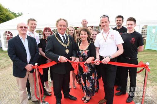 Mayor of Cambridge cutting the red ribbon