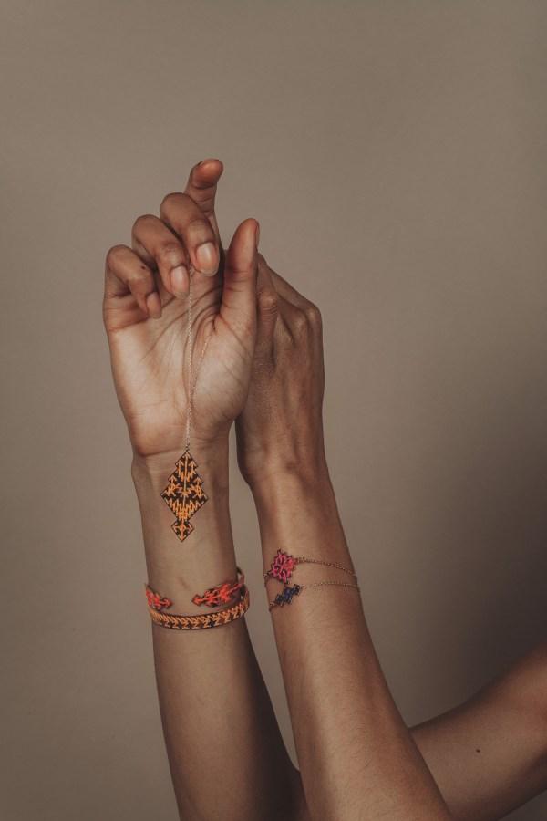 The Camelia bijoux - Collier Chellah jaune + Jonc Slaoui jaune + Jonc Bahia corail + bracelet Badi rose + bracelet Souika bleu.jpg