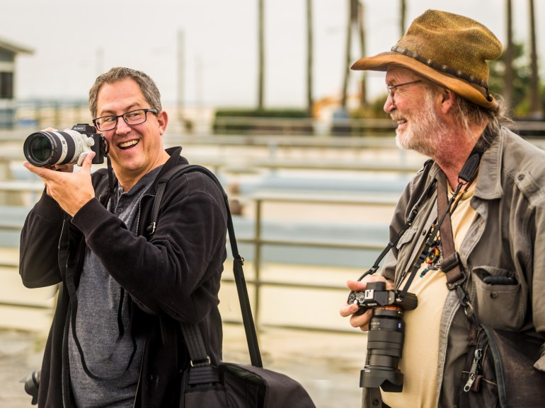 Paul Gero and Chuck Jones with Sony cameras near the entrance to the Seal Beach pier.   Image Credit: Jim Quinn.