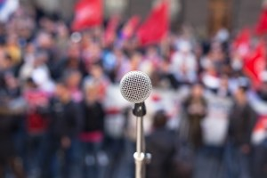 Speech writing - Microphone in front of a crowd before giving a speech