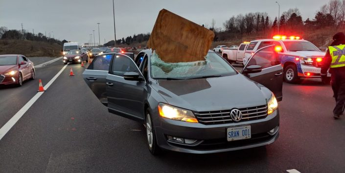 Two people dodge death as sheet of plywood smashes into windshield on Ontario highway