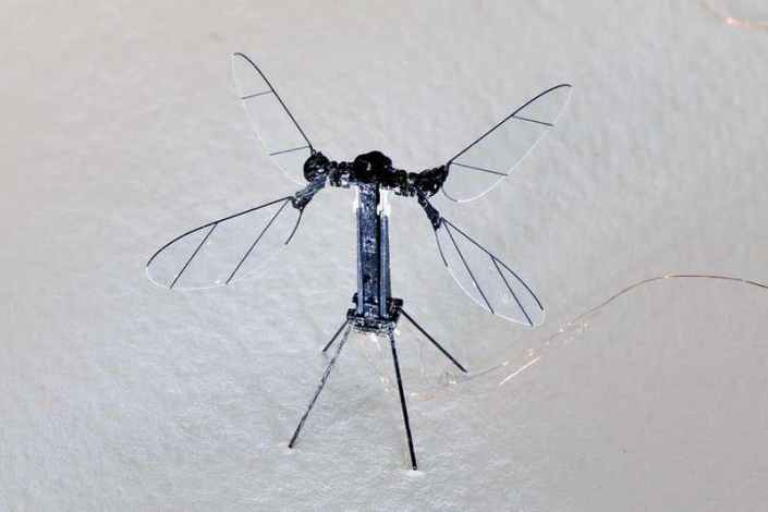 Tiny flying insect robot has four wings and weighs under a gram