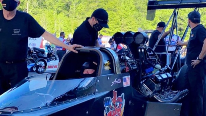 Top Fuel Dragster pilot Artie Allen waits to make a pass in his dragster