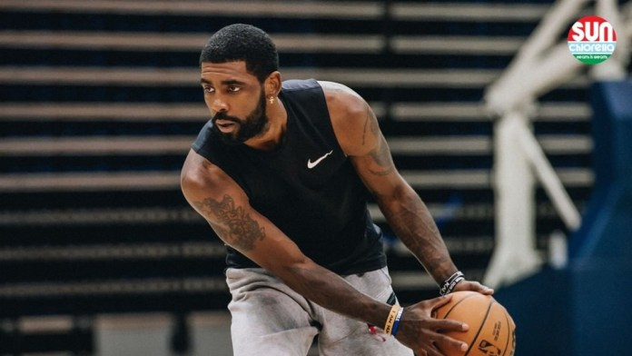 Brooklyn Nets star Kyrie Irving practicing with his teammates during training camp