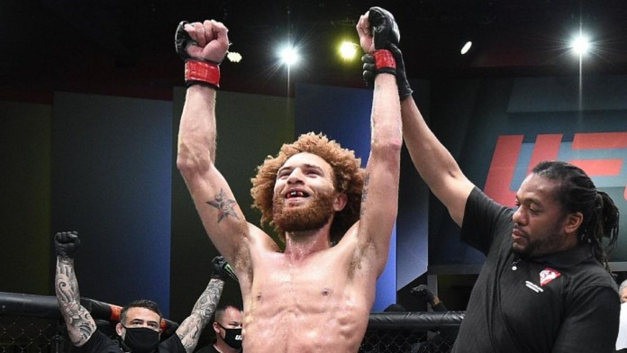 Former UFC fighter Luis Pena celebrates a win with the promotion
