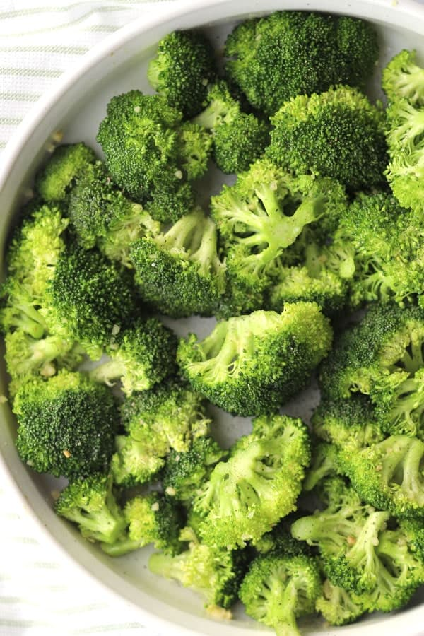 roasted broccoli recipe in a white round baking dish