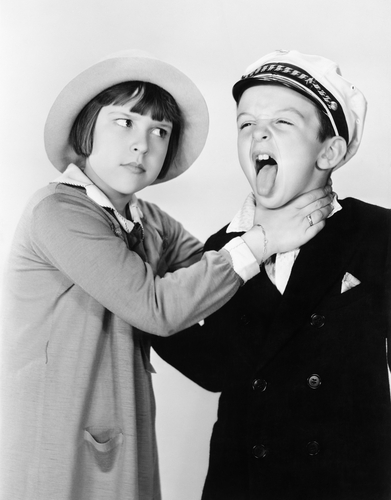 black and white film still of siblings fighting