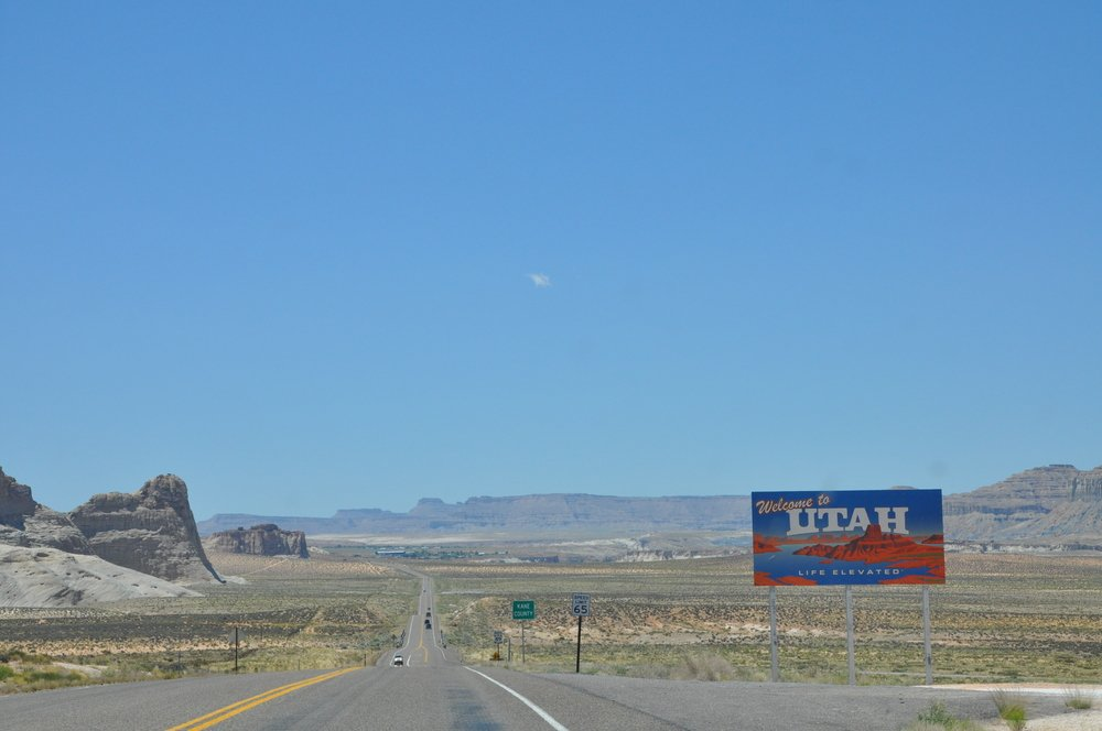 welcome to utah sign on the highway