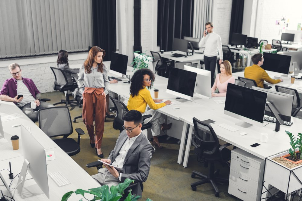 high angle view of professional young multiethnic business people working in open space office