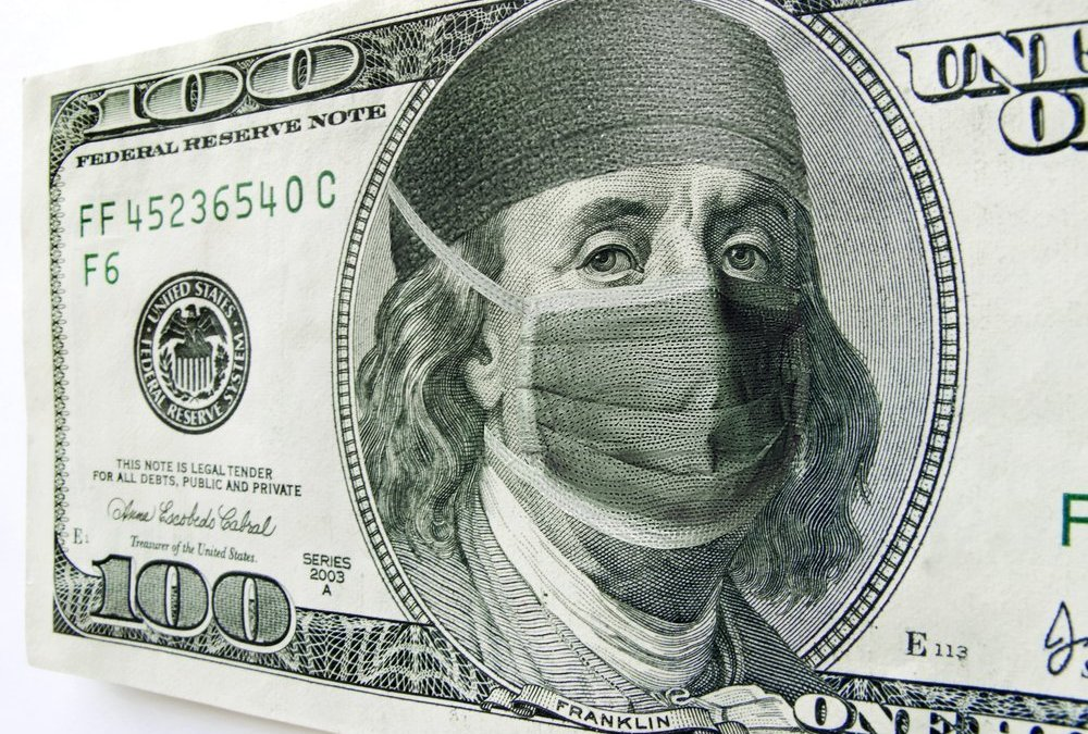 Photo illustration of Ben Franklin wearing a health care mask and bonnet on a one hundred dollar bill. Might illustrate the high cost of health care, Affordable Health Care Act or health insurance