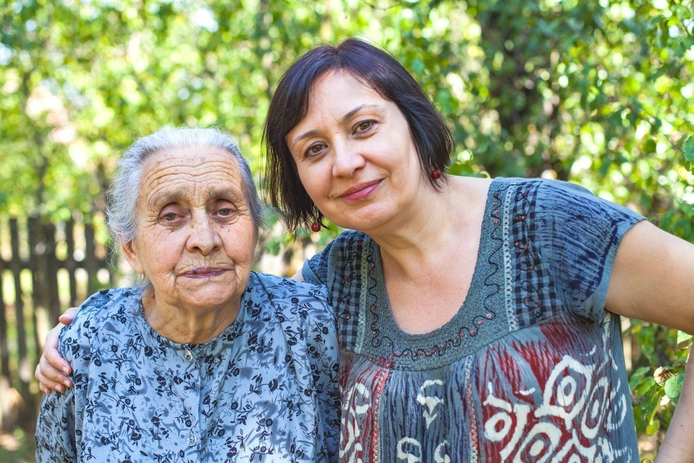 stock image of adult daughter and elderly mother