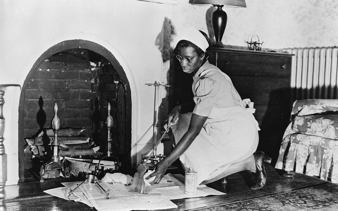 an african american maid cleaning a fireplace in 1942. image by the library of congress via wikimedia