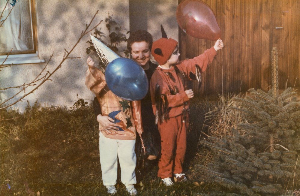 Vintage photo of mother with children disguised in Carnival costumes, early eighties
