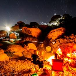 Campfire and climbers at Joshua Tree National Park, California, USA