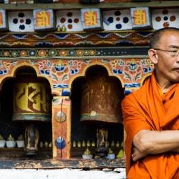 Monk and prayer wheels, Paro, Bhutan