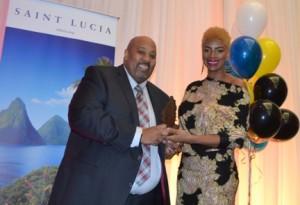 Young Professional Award winner Karlyn Percil-Mercieca receives her award from Ross Cadesse, president of Saint Lucia Toronto association