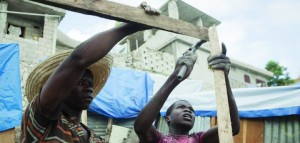 Workers help to restore earthquake damage in Haiti, which is also suffering a major drought.