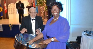 """""""Look, ah playing pan."""" Saint Lucia Gov. Gen. Pearlette Louisy enjoys a moment with veteran Trini pannist and teacher Tommy Crichlow during her Toronto visit. Gerald V. Paul photo. By Gerald V. Paul"""